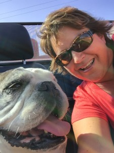 My mom & Marley riding in the convertible